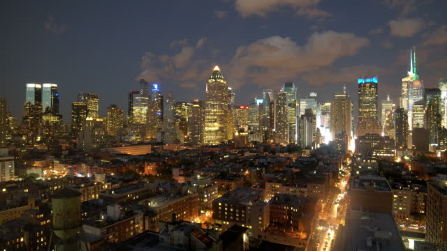 night time lapse establishment shot of new york city skyline. urban landmarks background