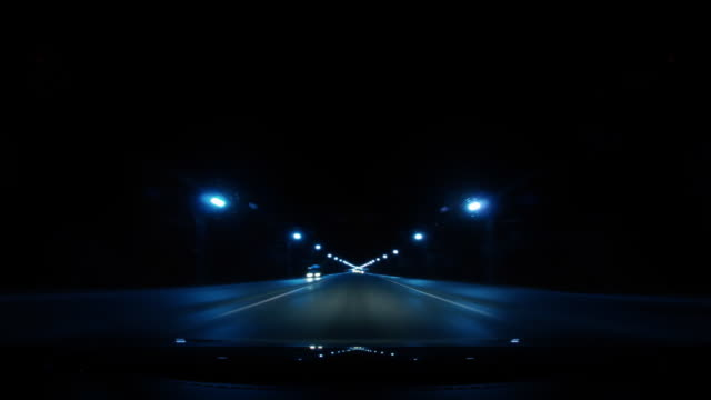 Night time lapse of a car driving
