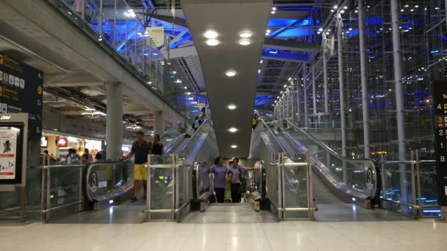 Night Time Lapse of Crowd using escalator at Airport terminal