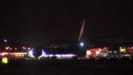 Night time shots of unidentified aircraft landing at Heathrow at night and taxiing in front of various airport lights No corporate livery can be...