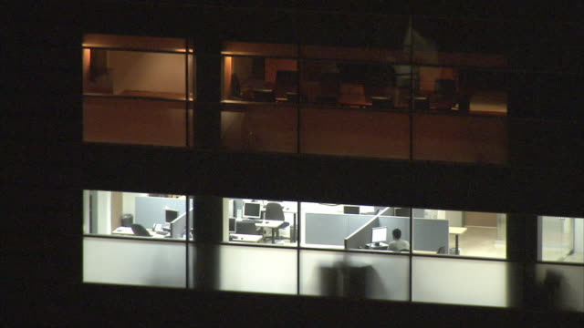 WS HA Night time view through window of lone worker still at office / Metropolitan District of Caracas, Miranda, Venezuela