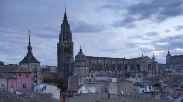 Night to day ZO TL of the city of Toledo at sunrise in Spain.