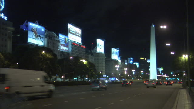 T/L, WS, night traffic on 9 de Julio Avenue with The Obelisk in background, Buenos Aires, Argentina