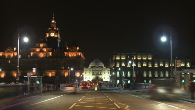 T/L, WS, Night traffic on street with General Register House and Balmoral Hotel in background, Edinburgh, Scotland, United Kingdom