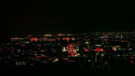 Night view of Kitakyushu City seen from the observation deck of Takatoyama Park Town area and a group of industrial plants colored red orange yellow...