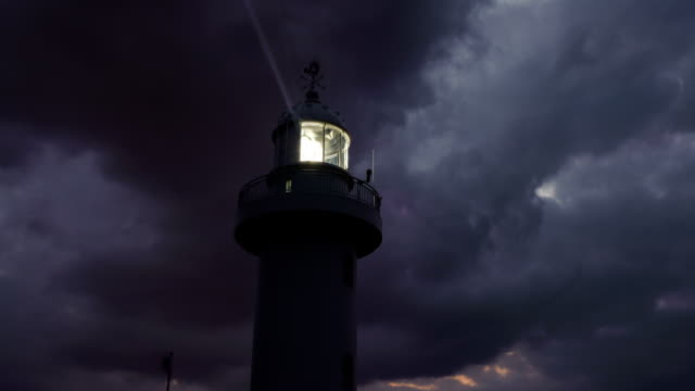 Night view of Sanji lighthouse and flowing clouds