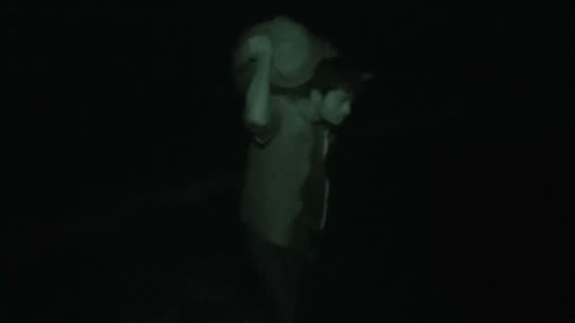 Night vision shots of Rohingya refugees wading through water carrying bundles of possessions after crossing from Myanmar's Rakhine State into...