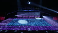 WS nightclub dance floor and bar lit up with flashing lights and disco ball