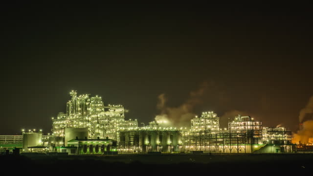 WS T/L Nightscape of petrochemical plant with smoke / Yeosu, Jeollanamdo, South Korea
