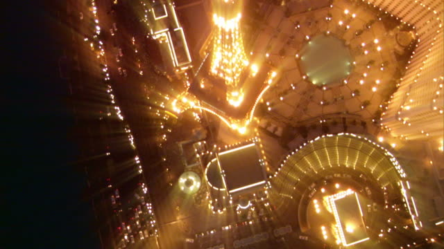 nighttime aerial looking straight down to Paris casino copy of Eiffel Tower with light streak effects / Las Vegas, Nevada, USA