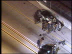 / nighttime high speed car chase as seen from news helicopter / suspect crashes headon into another car on freeway / cars smashed up as police...