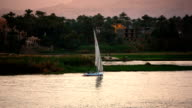 Nile River 'Feluccas' sailboat at sunset near Luxor Egypt