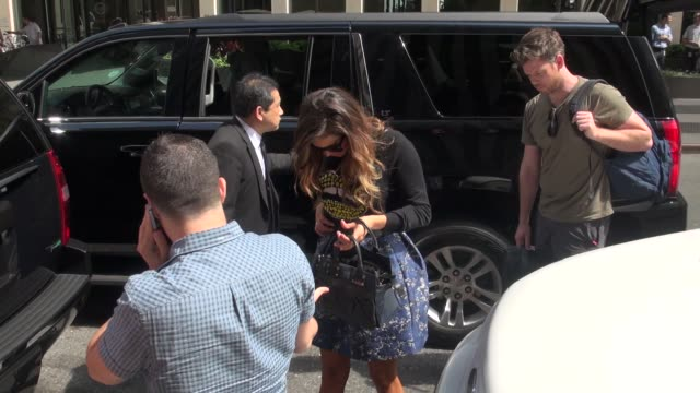Nina Dobrev arrives at SiriusXM Satellite Radio and almost falls as she is walking in and greets fans Celebrity Sightings in New York on August 04...