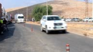 Nine UN trucks loaded with humanitarian aid packages cross the Cilvegozu border gate into the wartorn Syrian city of Idlib from the Turkish border...