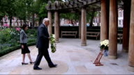 Ninth anniversary of New York 9/11 attacks commemorated in London wreathlaying ENGLAND London Grosvenor Gardens EXT Man laying wreath at British...