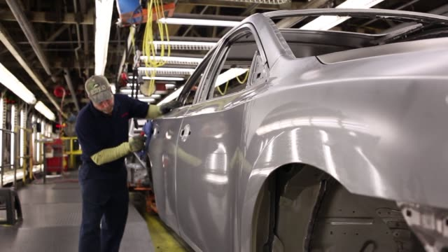 Nissan automobiles are welded painted assembled and inspected at Nissan Motor Manufacturing in Smyrna Tennessee US Nissan employees collect various...