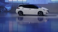 Nissan Motor Co's new Leaf electric vehicle appears on the stage at the unveiling in Chiba Japan on Wednesday Sept 6 2017 Photographer Kiyoshi Ota...