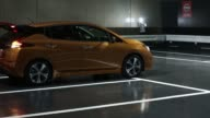 Nissan Motor Co's new Leaf electric vehicle is driven during a test drive for the ProPilot Park system at the unveiling in Chiba Japan on Wednesday...