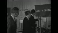 Nixon meets Commander of the American Legion James F O'Neil on street under 3D sign in chrome 'Chrysler' / Nixon O'Neil and Tom F Morrow General...