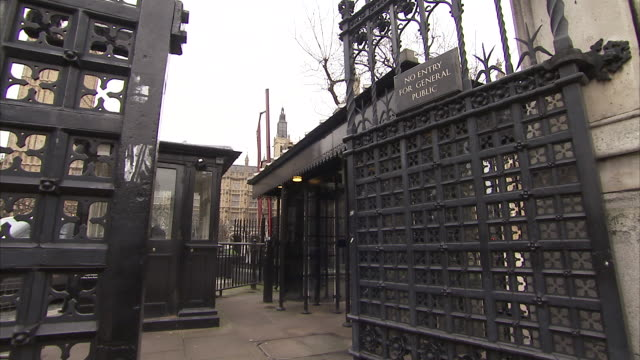 A 'No Entry' sign hangs on a House of Parliament gate. Available in HD.