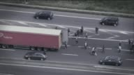 Story of Lawand a profoundly deaf Iraqi refugee LIB / TX FRANCE Calais Migrants jumping into back of slow moving lorry queuing at port of Calais