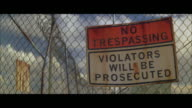 MS POV 'No Trespassing' sign on wire mesh fence