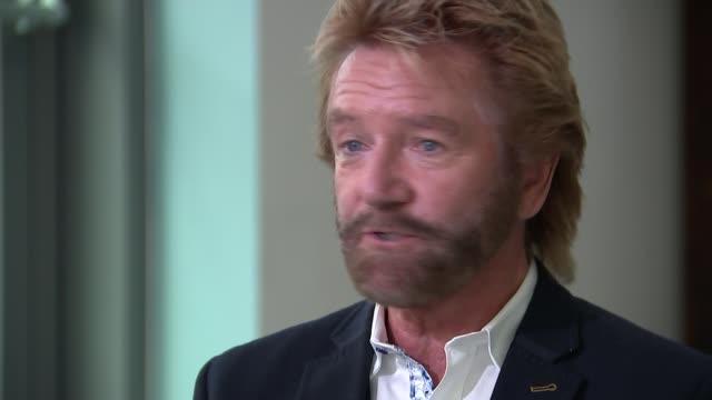 Noel Edmonds' court case against Lloyds Bank London INT Noel Edmonds setup shots / interview SOT