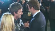 Noel Gallagher Bradley Cooper at 'Burnt' UK film premiere on October 28 2015 in London England