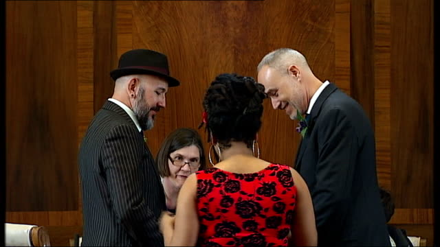 Noel Regan and Matthew Johnson's Stoke Newington wedding Noel Regan and Matthew Johnson's wedding ceremony conducted by registrar / Signing of...