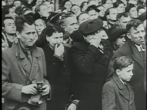 Noncommunist Foreign Minister Jan Masaryk funeral people walking in street crowd w/ people crying people on line to pay respects VS Body Lying in...