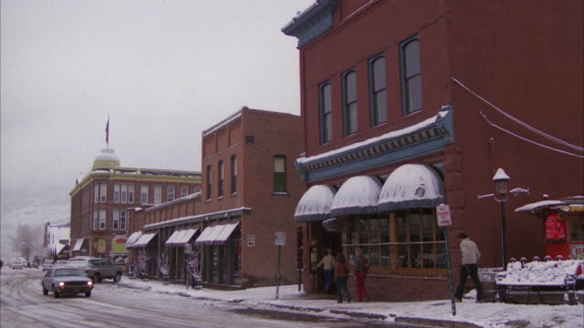 MS ZI Nondescript bar at main street in aspen with snow