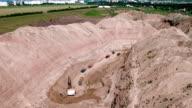 Non-urban scene. Lorries in sand quarry