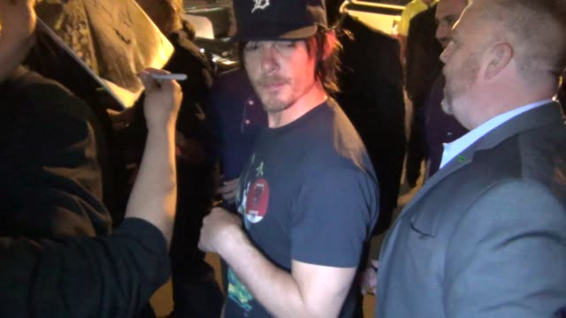 Norman Reedus signing autographs at Celebrity Sightings ComicCon International 2013 Norman Reedus signing autographs at Celebrity on July 19 2013 in...