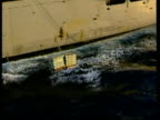 North Korean nuclear programme LIB ARABIAN War planes on deck of US aircraft carrier USS Abraham Lincoln Helicopter lowering cargo to deck Cargo...