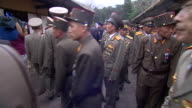 North Korean soldiers crowd into a shrine to the countires founding president Kim IISung