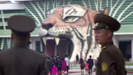 North Korean soldiers standing outside the entrance of the capitals zoo