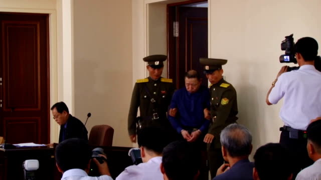 North Korea's top court on Tuesday sentenced two South Korean men who were captured as 'spies' last year to hard labor for life saying that they had...