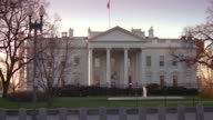 MS North lawn of white house with fence and barriers at late evening / Washington D.C., United States