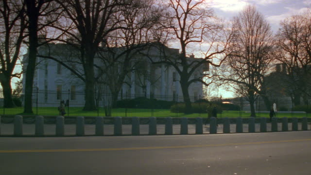 MS North lawn of white house with traffic / Washington D.C., United States