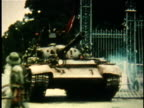 North Vietnamese tank crashing through gates of presdiential palace during the fall of Saigon / South Vietnam