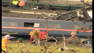 Selby train crash general views of site and emergency workers ENGLAND North Yorkshire Near Selby Great Heck EXT Helicopters in field pan along as...