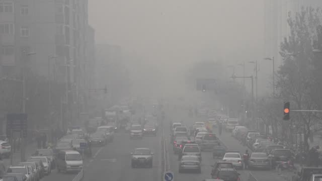 Northern China choked under some of the worst smog this year with Beijings pollution soaring to 22 times healthy limits triggering the citys second...