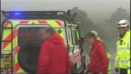 Army cadets rescued from Mourne Mountains NORTHERN IRELAND Mourne Mountains EXT Mountain Rescue van along past emergency workers Emergency workers...