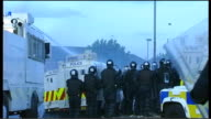 UTV Northern Ireland Troubles Footage Clipreel 169 1272005 Ardoyne Police vehicles along including one with water cannon as confronting rioters /...