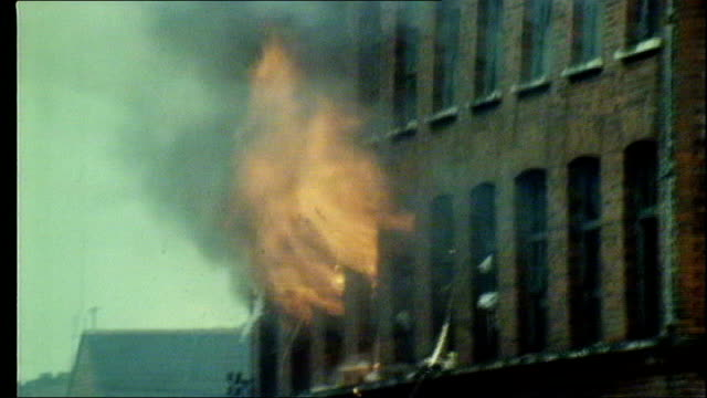 UTV Northern Ireland Troubles Footage Clipreel 43 1341972 More of army and fire brigade outside burning building / Various shots of building on fire...