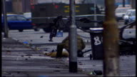 UTV Northern Ireland Troubles Footage Clipreel 43 Bomb disposal squad ATO officer diffusing bomb in cordoned off section of road / Army vehicles on...