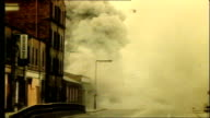 UTV Northern Ireland Troubles Footage Clipreel 43 Large explosion in building and aftermath clouds of dust smoke army and emergency services rubble...