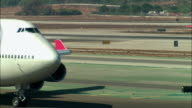 CU, Northwest Airlines jet taxiing in runway, Los Angeles, California, USA