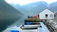 Norway cruise Hurtigruten beautiful little town of 43 people with marina and restaurant in Hjorundjorden area of Norway