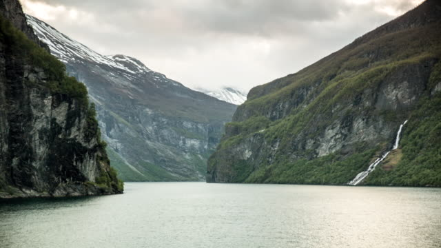 Norway, Geiranger, Geiranger fjord. Unesco World Heritage site. View on mountains and waterfall